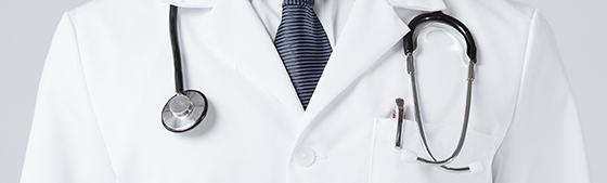 bright close up of male doctor with stethoscope